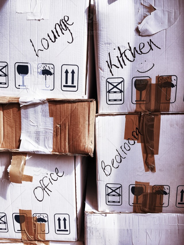 stock-photo-box-stacked-moving-boxes-tape-moving-house-packing-moving-day-moving-boxes-58ec8a6d-6f59-4433-b930-fff4b0d06a9c